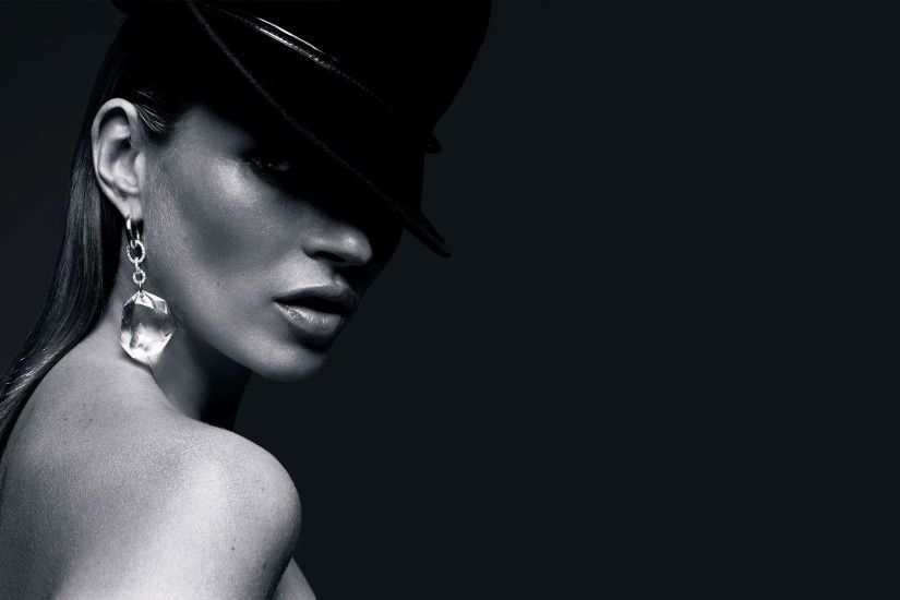 Kate Moss with a black hat