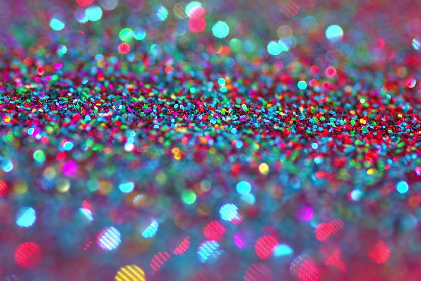Sparkly glitter background in bright colors. Great party background texture