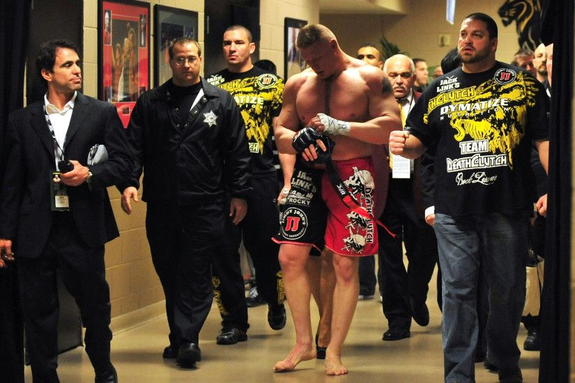 Brock Lesnar walks back to his locker room after announcing his retirement  after his loss to