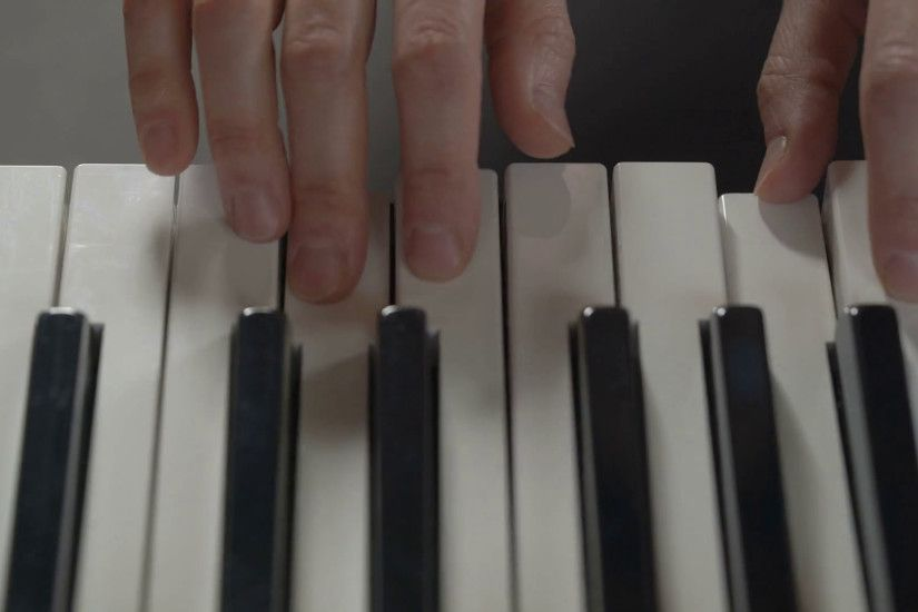 Hands of a woman playing the piano on black background, top view, closeup  Stock Video Footage - VideoBlocks