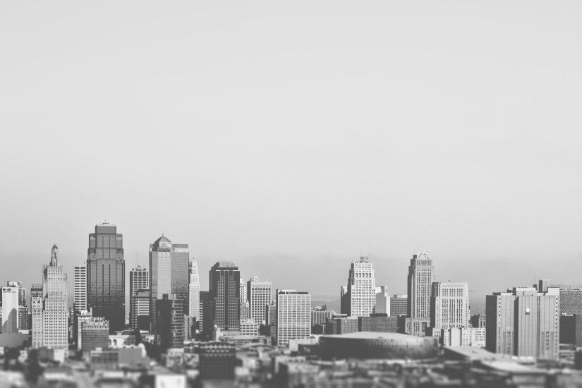 This black and white picture shows the downtown and business district of a  typical american city