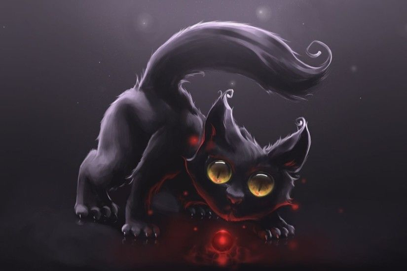 Cute Black Cat Playing With A Red Orb