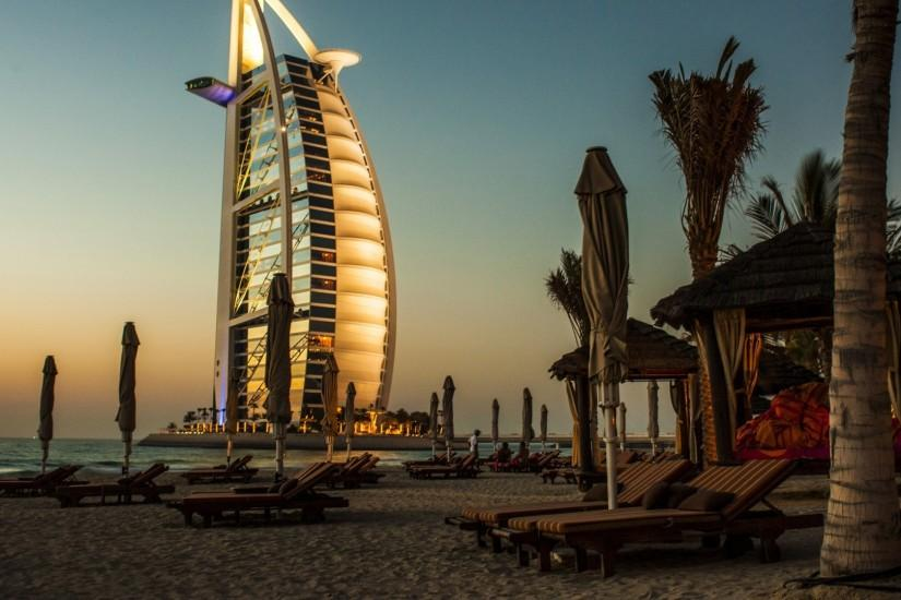 Preview wallpaper dubai, burj al arab, palm trees, deck chairs, beach  1920x1080