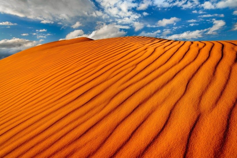 Vibrant Orange Sand Dunes wallpapers and stock photos