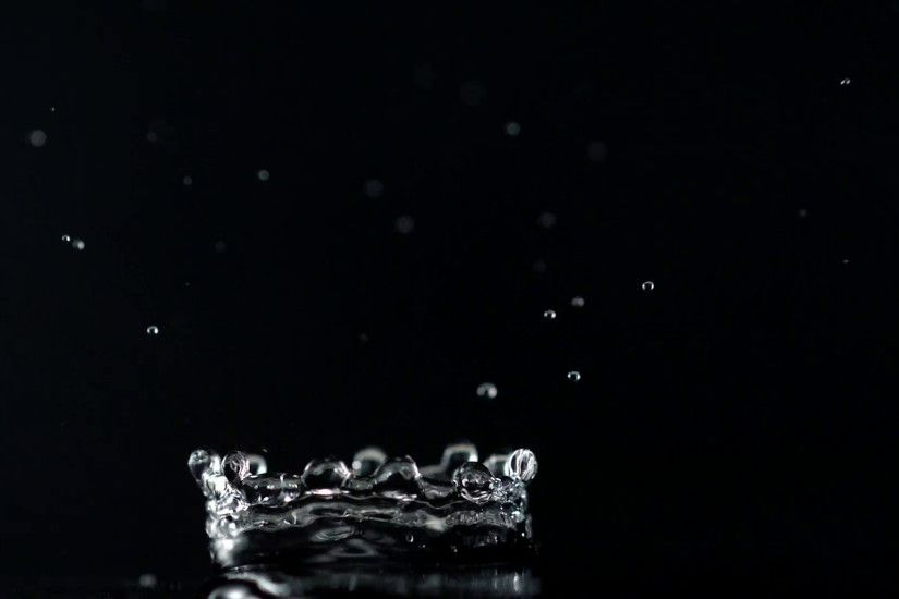 Water drop making splash on black background, Slow Motion Stock Video  Footage - VideoBlocks