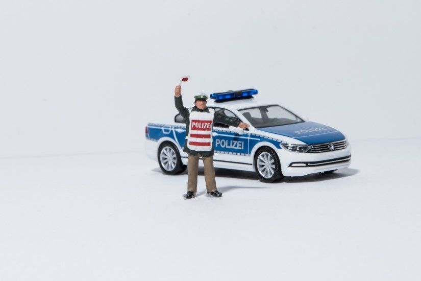 policeman and police car plastic toy