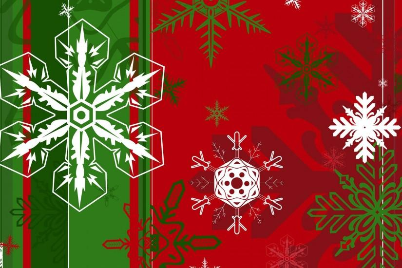 Snowflakes of different shapes on the green and red background on Christmas