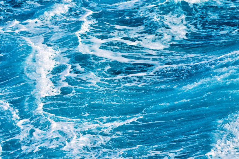 Blue background photo of some ocean waves