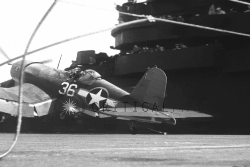 Crashing of F4U Corsair airplane during landing on USS Bunker Hill in World  War I...HD Stock Footage