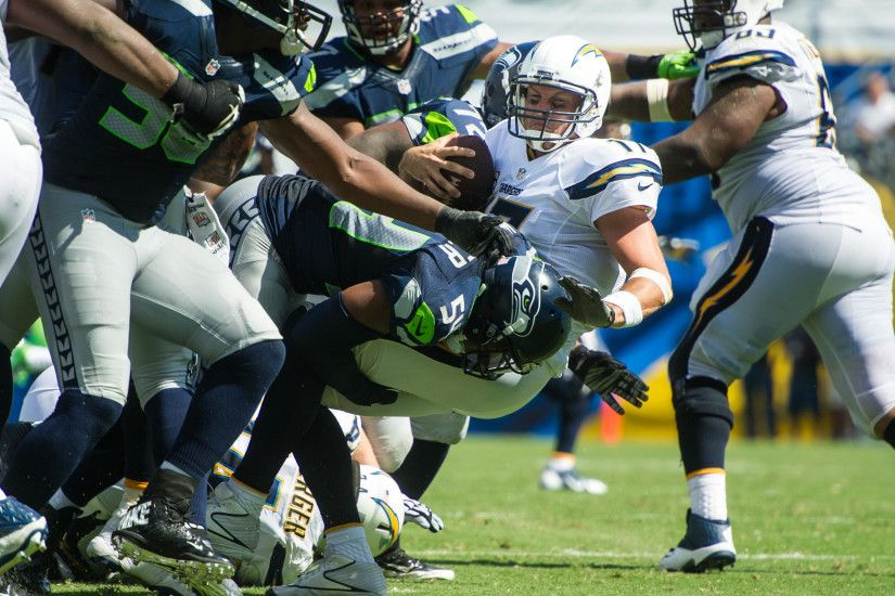 Seattle's Bobby Wagner brings down San Diego quarterback Philip Rivers in  the second half.