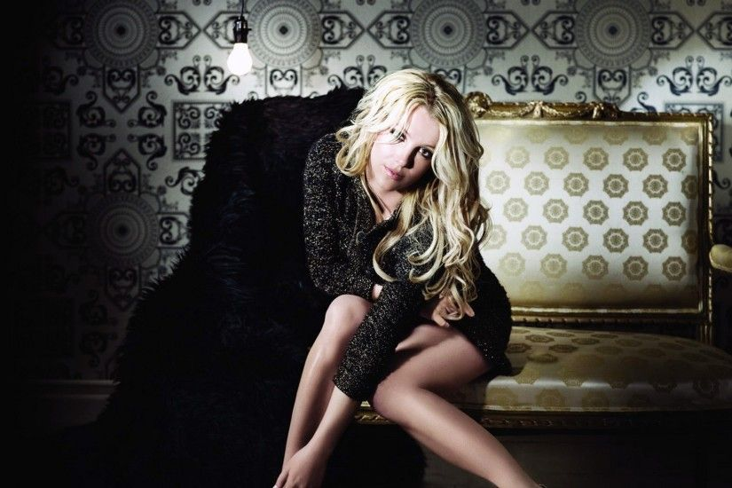 Preview wallpaper britney spears, blonde, dress, style, gesture, shadow,  sofa