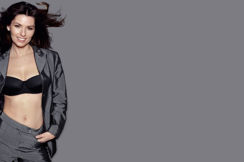 Shania Twain in a gray suit wallpaper