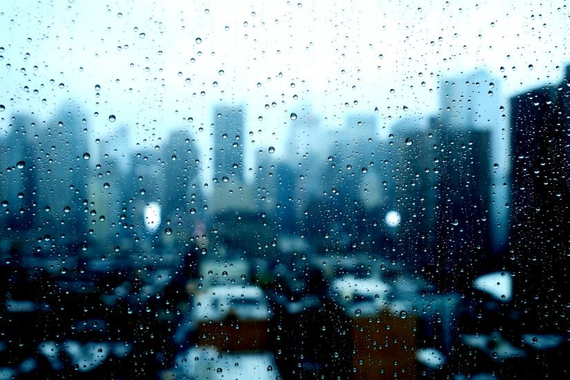 blurry city skyline window view. sad bad weather. rain drops background