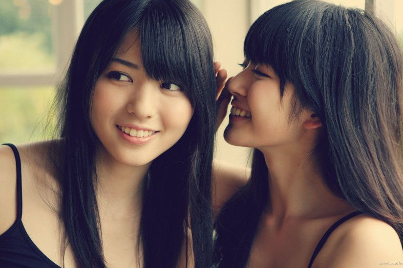 Cute Asian Girls Gossiping picture