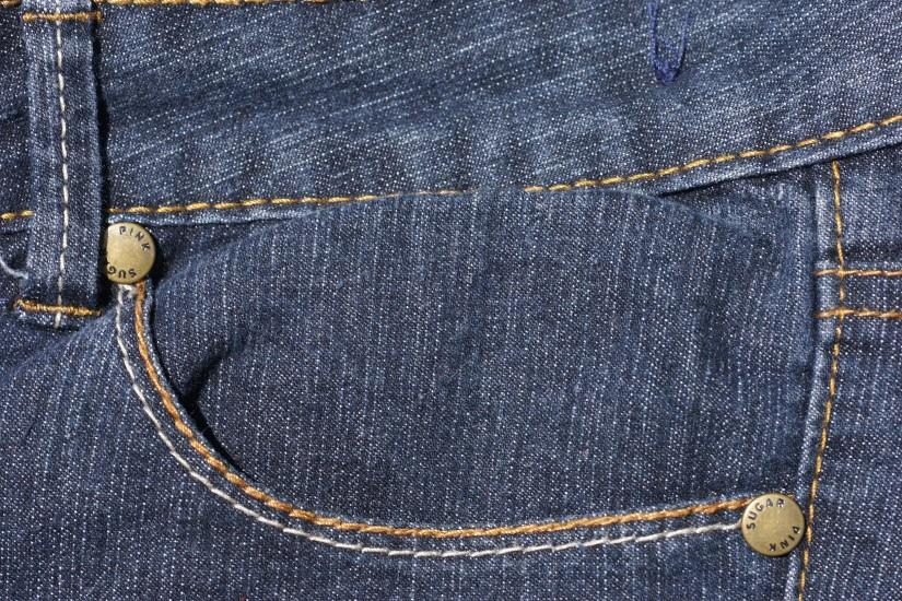 Hi, Here is a free black denim jeans texture background. black pocket of  denim jeans background