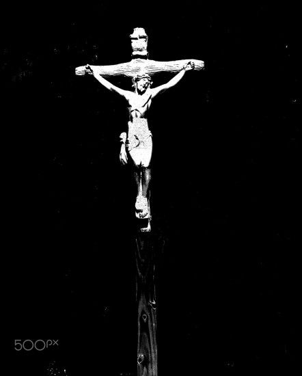 An icon of Jesus crucified - The Crucifixion in artistic black background