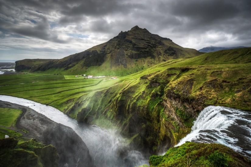 Iceland nature landscapes hills mountains waterfalls grass rocks water  rivers fog mist haze spray canyon sky