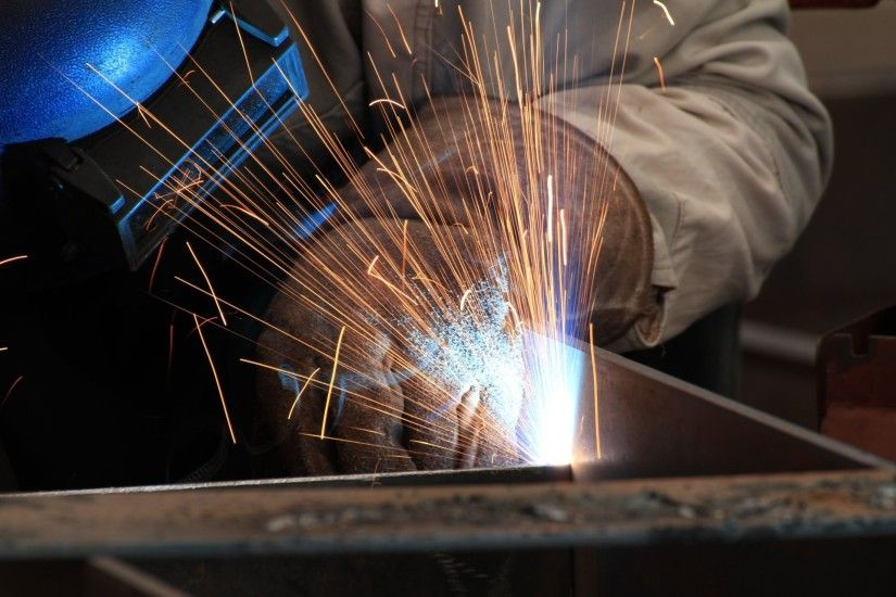 welder welding electrical arc sparks heat personal protective equipment