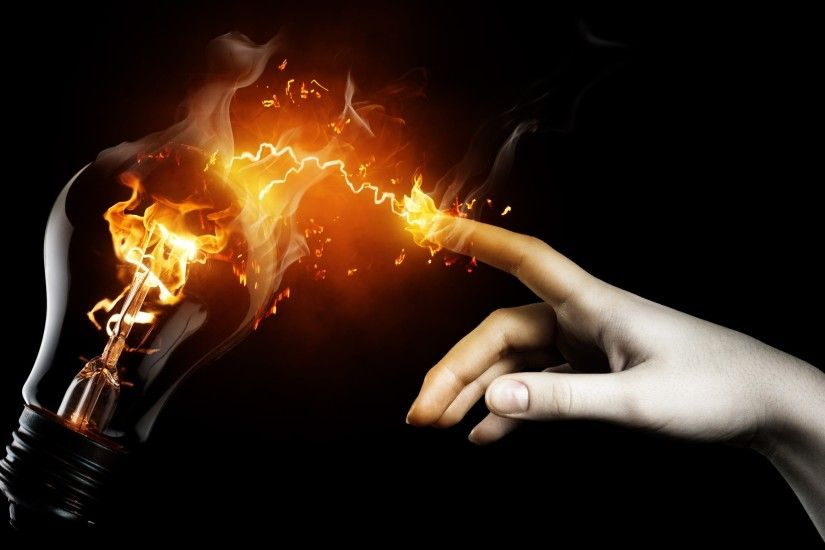 Hand with Fire Spark Touching Lamp wallpaper
