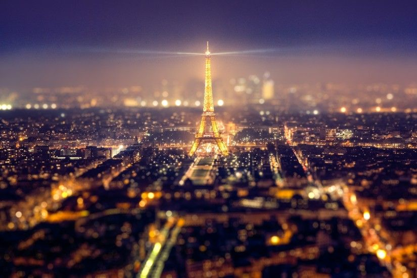 zoom out tilt shift Eiffel Tower paris at night lighting for tall buildings desktop  background