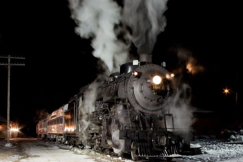 Title. Steam locomotive at night