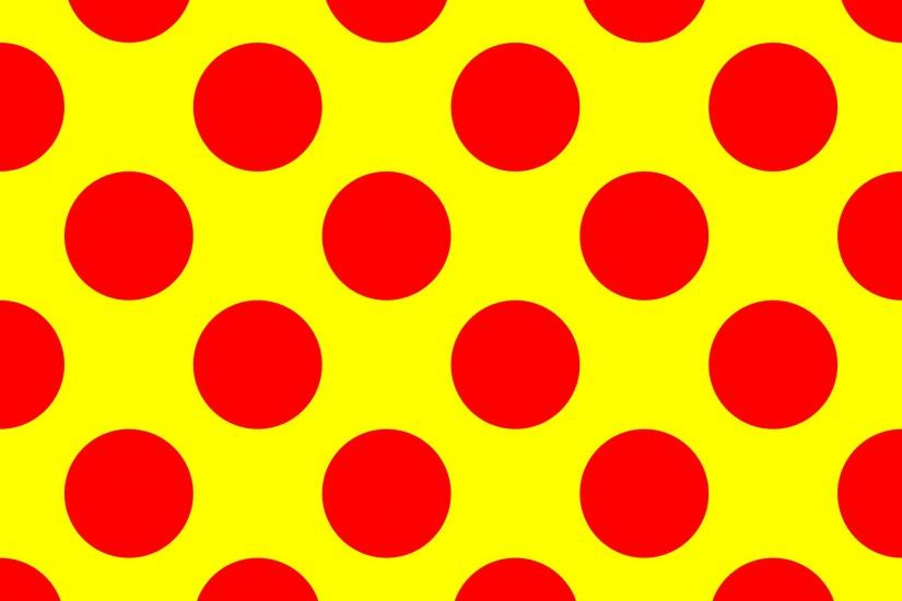 Red polka dots on a yellow background