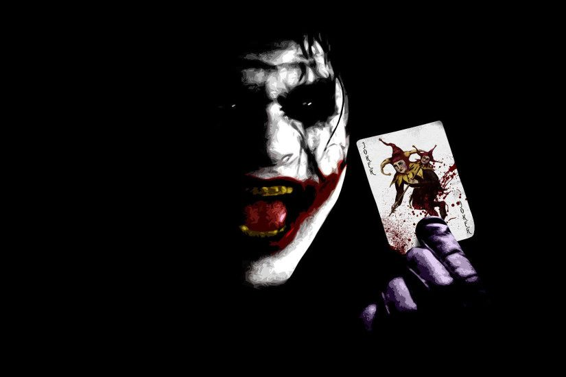 The Joker holding a card - The Dark Knight wallpaper