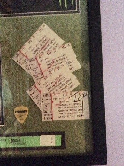 Theory Of A Deadman picture that's hanging in my room one of the seats says  18