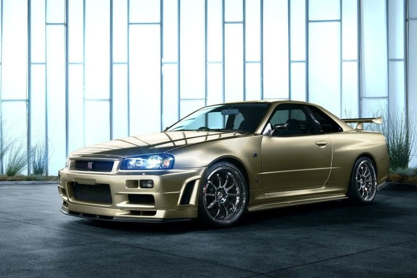 Preview wallpaper nissan skyline, r34, golden, side view 2048x1152