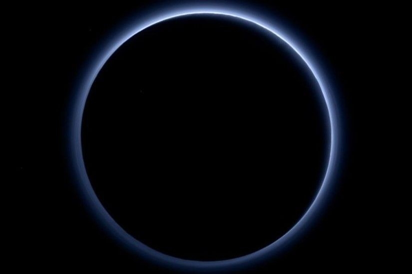 Pluto's haze layer shows its blue color in this picture taken by NASA's New  Horizons.
