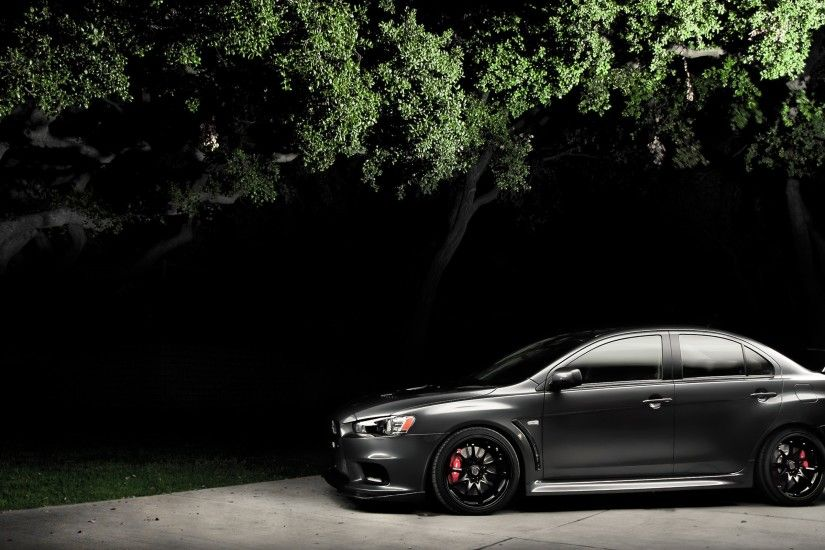Black Mitsubishi Lancer Evo X in the night
