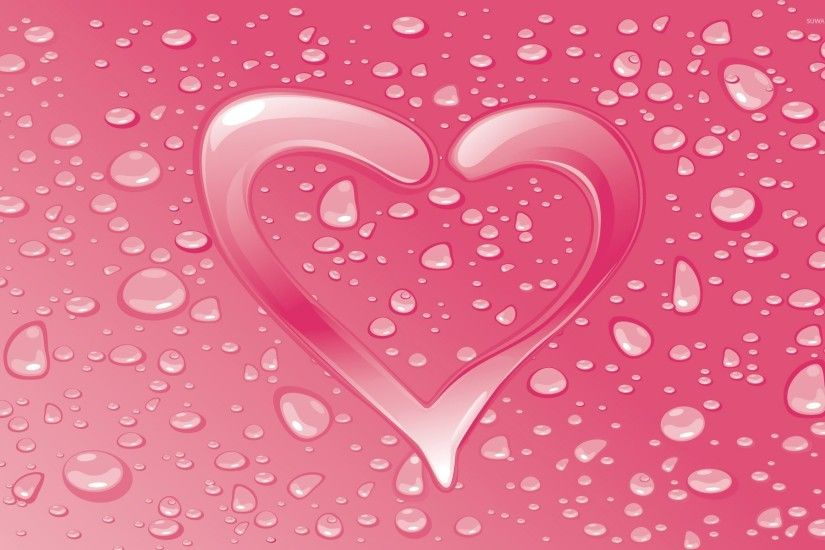 Water drops on the pink heart wallpaper