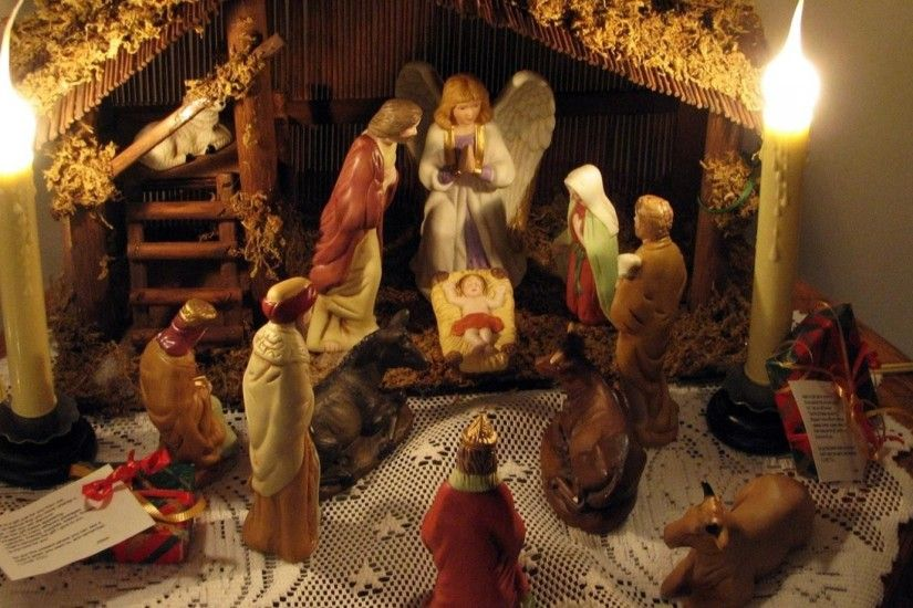 Preview wallpaper christmas, holiday, candles, jesus, angel, figurines,  people 1920x1080