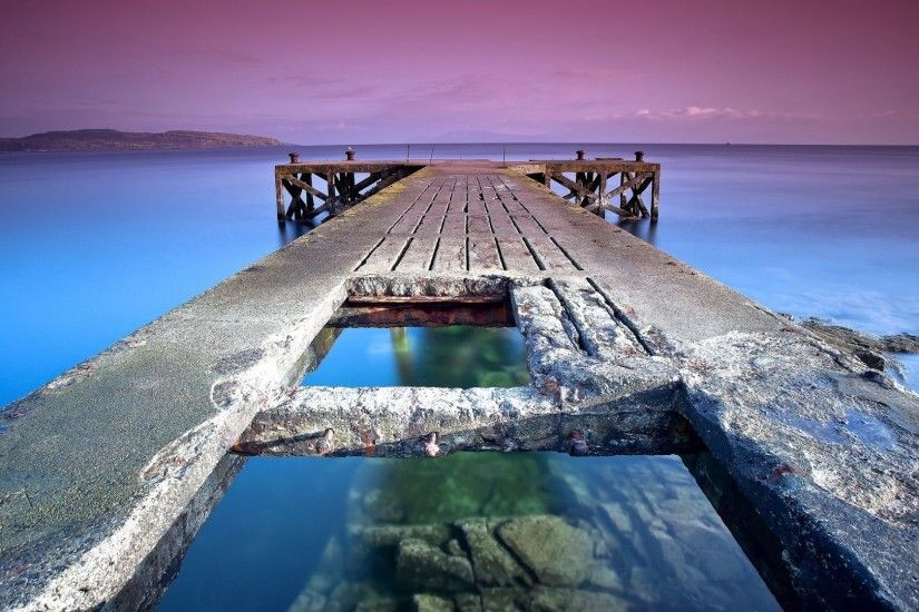 Stone pier towards the purple sunset wallpaper