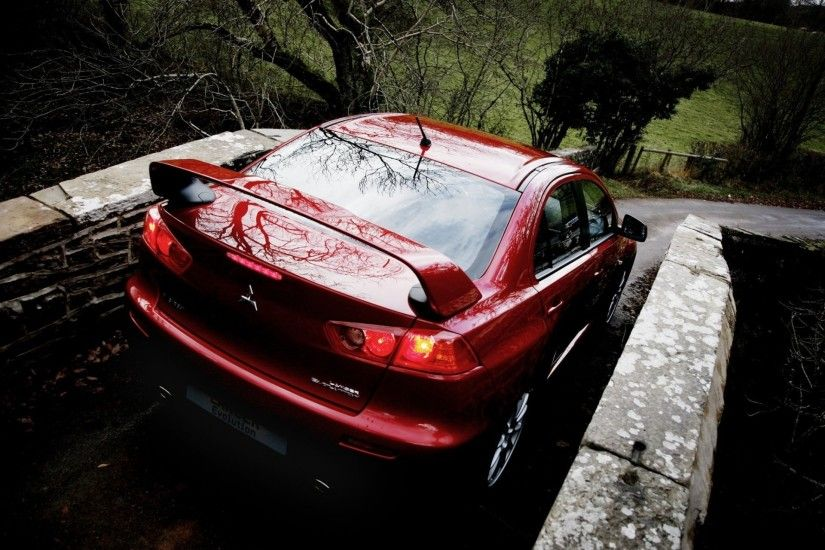 mitsubishi lancer evolution x machine back of red wallpaper