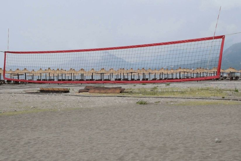 volleyball court on the beach, people passing by Stock Video Footage -  VideoBlocks