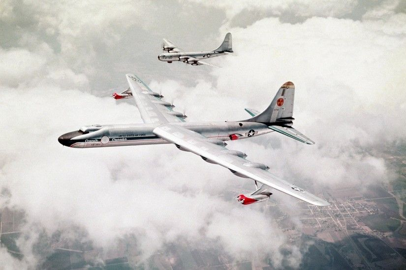 two usaf bombers b-29 sky land of the field clouds