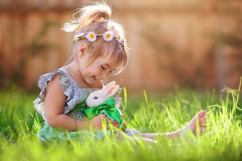 Child Girl Playing with White Rabbit Wallpaper