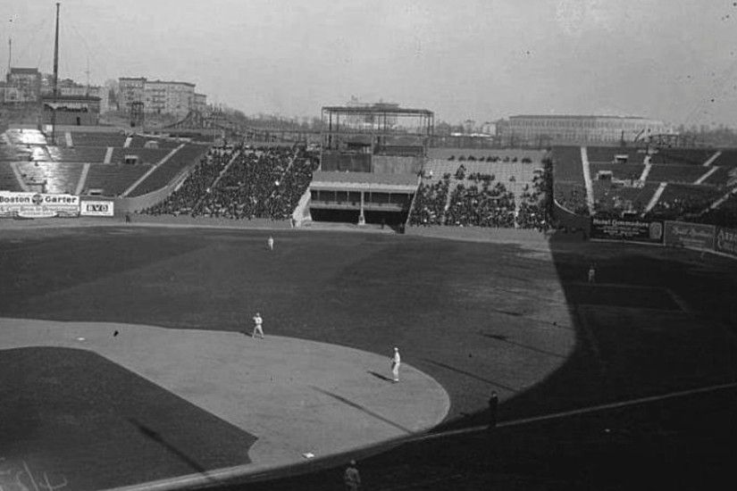 This photograph taken at the Polo Grounds with Yankee Stadium in the  background was possible only for a brief period. Less than a year, in fact.