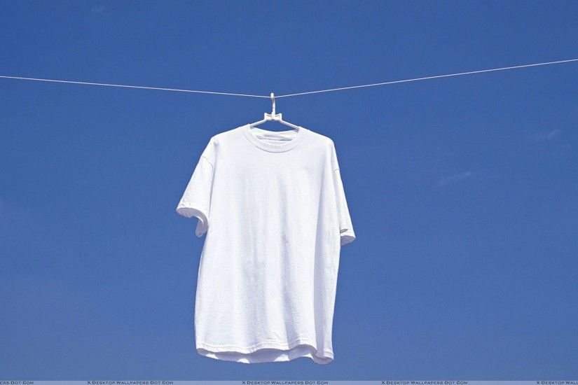 White T-Shirt Hanging N Blue Background