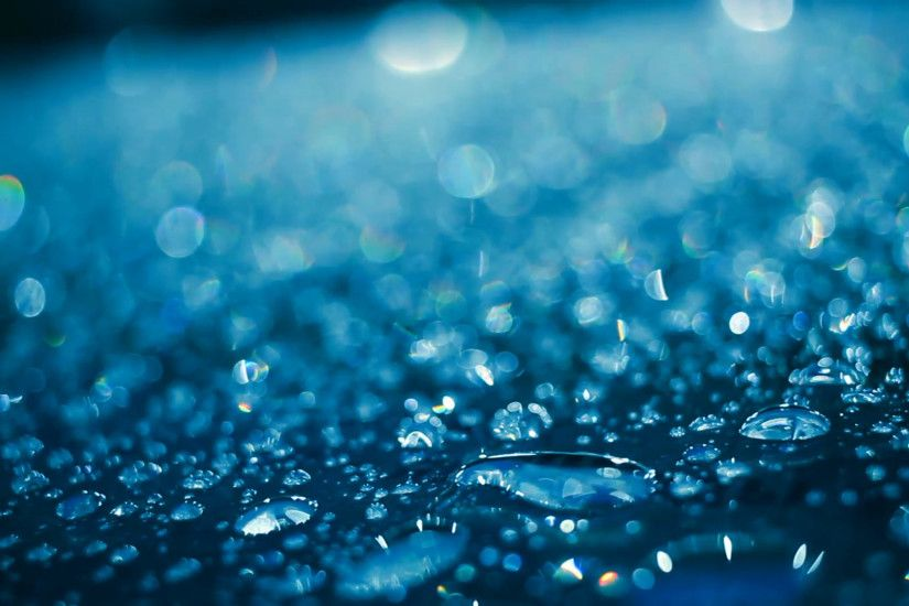 Water droplets on glass in blue color. Shiny droplets. Shimmering drops on  glass at night. Abstract background. Droplet background.