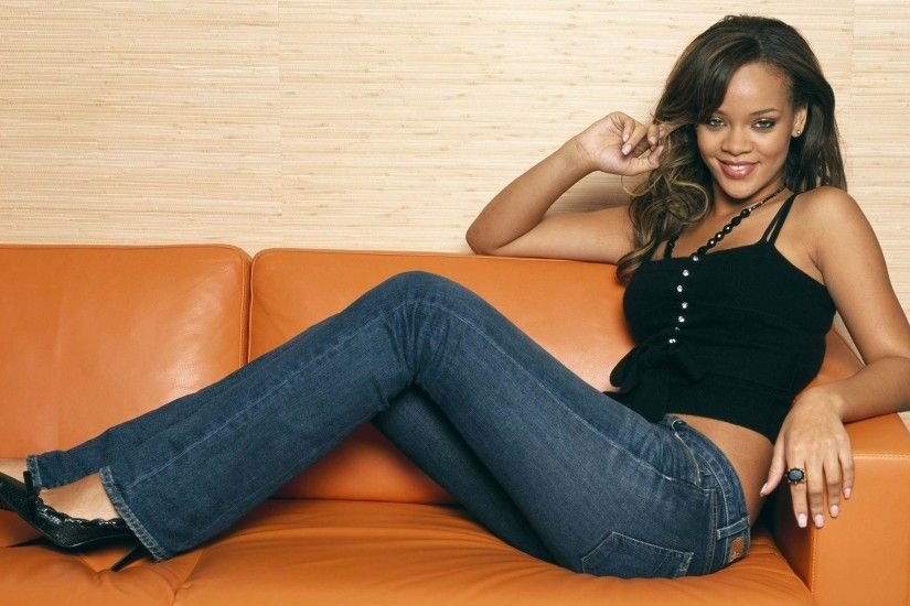 Rihanna sitting on the orange couch