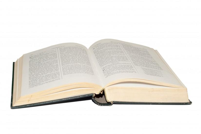 A hardcover bible showing open pages.