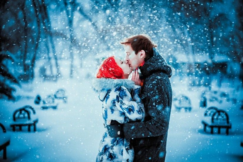 Happy Young Couple in Winter Park having fun.Family Outdoors. love kiss